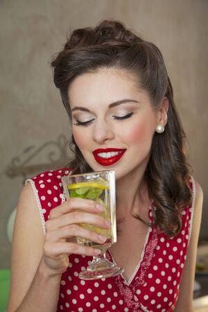 soda pops: A retro-style girl drinking lemonade LANG_EVOIMAGES