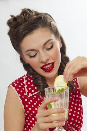 soda pops: A retro-stlye girl drinking lemonade LANG_EVOIMAGES