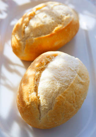 in twos: Two baguette rolls