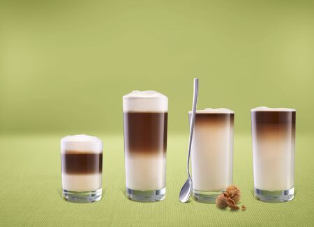 hot coffees: Various glasses of latte macchiato