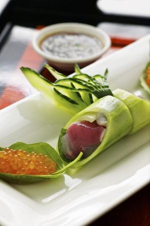 tunafish: Cucumber rolls with tuna fish and char caviar with a wasabi dip (Asia)