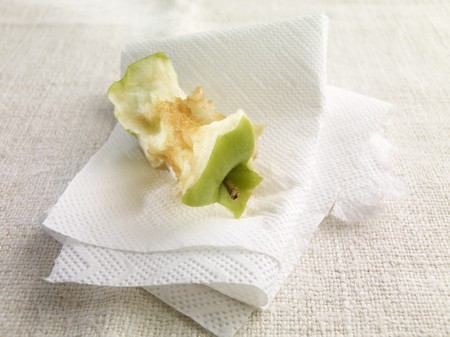apple core: An apple core on kitchen paper