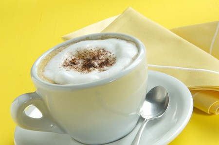 hot coffees: A cup of cappuccino LANG_EVOIMAGES