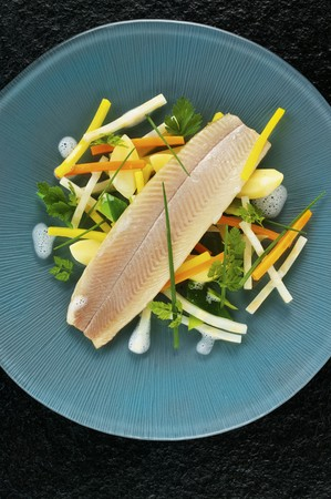 salmo trutta: Poached trout fillet with root vegetables and herbs