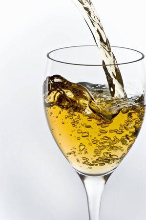 sauvignon blanc: Sauvignon Blanc Wine Pouring into a Glass