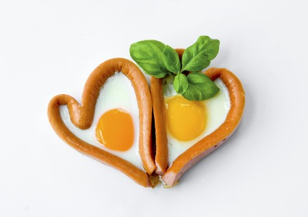 weenie: Two sausage and fried egg hearts