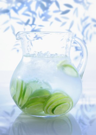 soda pops: A jug of water with limes