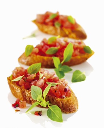 several breads: Bruschetta with chopped tomatoes