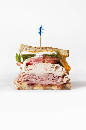 turkey bacon: Ham, Turkey, Bacon, Lettuce, Tomato and Cheese Sanwich with Toothpick