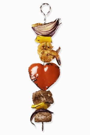broiling: A kebab with meat, prawns, onions and a heart-shaped piece of pepper