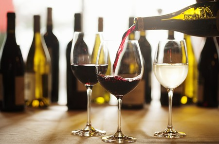 wine glasses: Red Wine Pouring into a Glass from Bottle; Glasses and Bottles of Wine