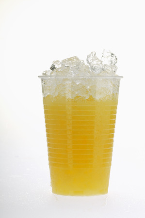glace pil�e: Orange juice in plastic tumbler with crushed ice