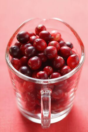 vaccinium macrocarpon: Cranberries in glass jug
