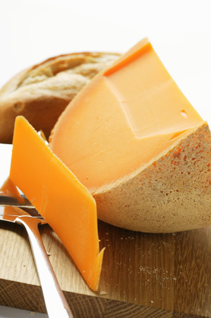 parer: Cheddar with cheese slicer on chopping board