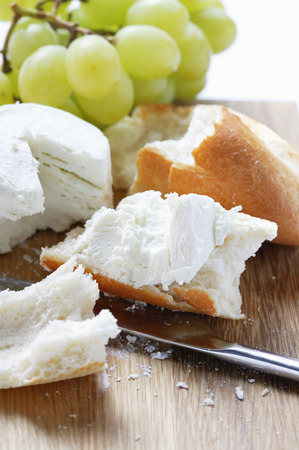 several breads: Fresh goats cheese with baguette and grapes