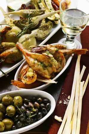 grissini: Antipasti platter, scampi and olives; grissini LANG_EVOIMAGES