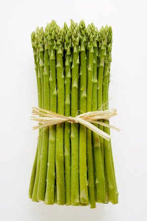 bunched: Bundle of green asparagus with drops of water