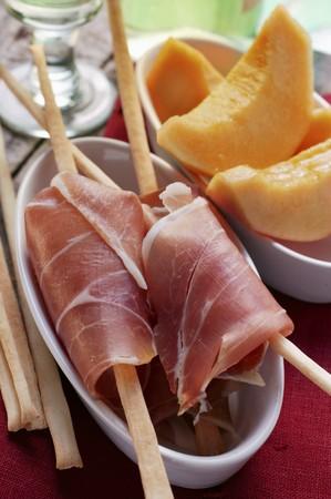 grissini: Parma ham with grissini; melon