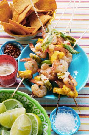 cuisines: Mexican shrimp kebabs; limes; tortilla chips