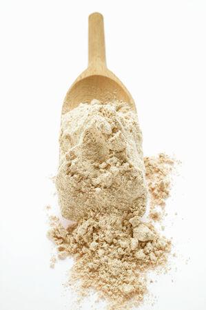 wooden scoop: Wholemeal flour on wooden scoop LANG_EVOIMAGES