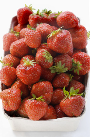 fragaria: Fresh strawberries in cardboard punnet LANG_EVOIMAGES