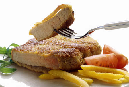 breaded pork chop: Breaded pork chop garnished with vegetables