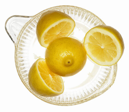 squeezer: Lemons in citrus squeezer LANG_EVOIMAGES