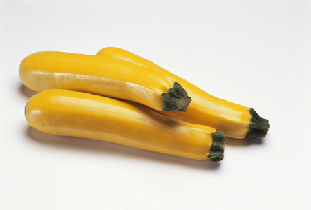 courgettes: Three yellow courgettes