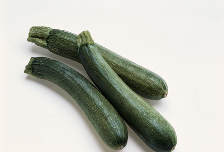 courgettes: Three young courgettes LANG_EVOIMAGES