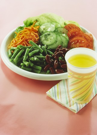 soda pops: Mixed vegetable salad on plate; lemonade