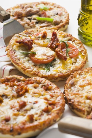 tunafish: Four different mini-pizzas and bottle of olive oil