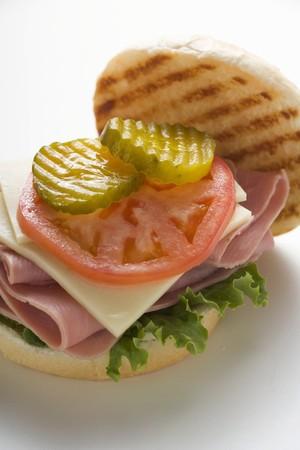 kaiser: Ham, cheese, tomato and gherkin in kaiser roll