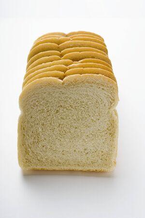 several breads: White sliced bread