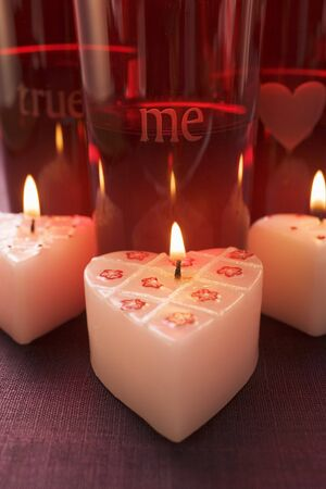 Burning heart-shaped candles for Valentines Day