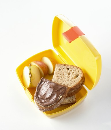 nutella: Nutella sandwiches and apple in lunch box LANG_EVOIMAGES