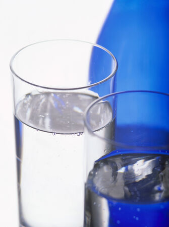 twos: Two glasses of water in front of blue water bottle