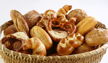 several breads: Basket of assorted baked goods