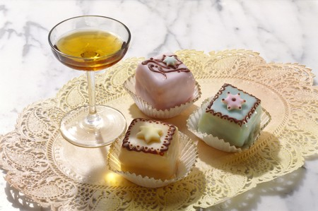 petit: A glass of Amaretto with petit four
