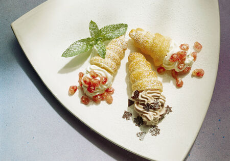 danish puff pastry: Three Cream Filled Puff Pastries with fruit and Chocolate LANG_EVOIMAGES