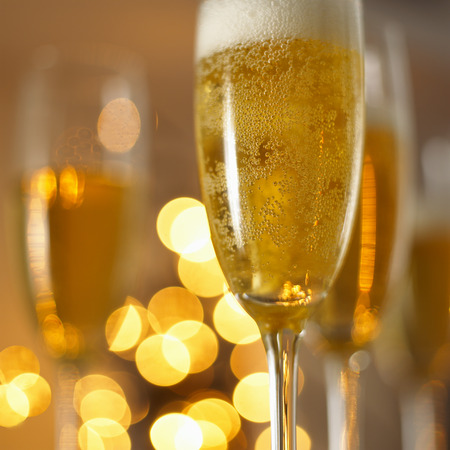 champers: A glass of champagne in festive light