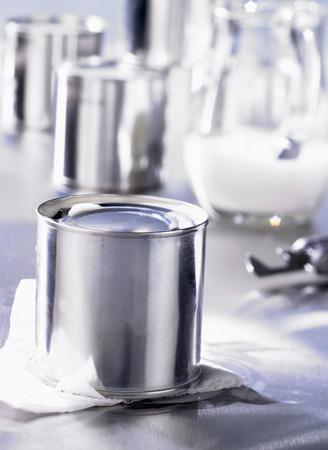 tinned: Tinned milk, milk jug in background