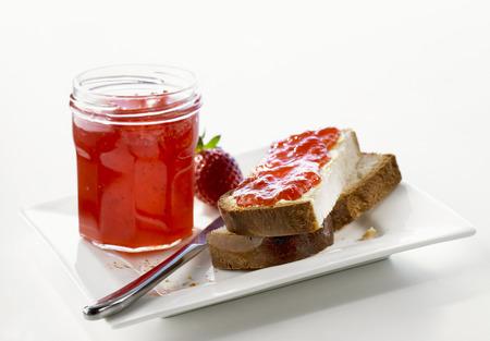 perishable: Strawberry jam in jar & on Blatz (sweet yeasted white bread)