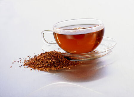 rooibos tea: Cup of rooibos tea and fresh rooibos beside it