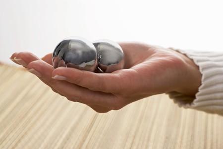 qigong: Qi Gong balls in a woman�s hand