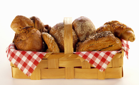 several breads: Bread basket with pretzels, bread rolls and pretzel sticks