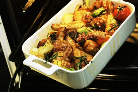 ovenbaked: Oven-baked chicken thighs with vegetables and rosemary
