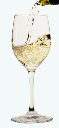 white wine glass: White wine being poured into a white wine glass LANG_EVOIMAGES