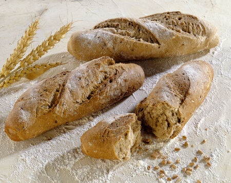 several breads: Three baguette rolls