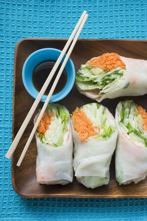well made: Rice paper rolls with soy dip and chopsticks LANG_EVOIMAGES