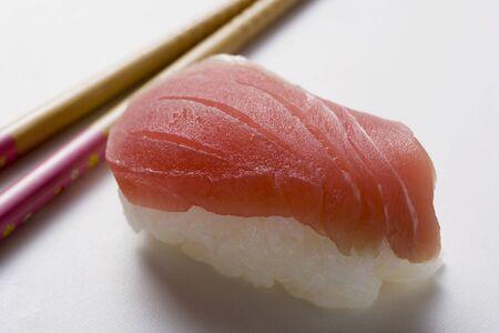 tunafish: Nigiri sushi with tuna, chopsticks